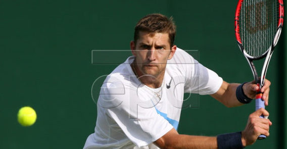 Max Mirnyi of Belarus eyes the ball during his 2nd round match against Guillermo Canas of Argentina for the Wimbledon Championships at the All England Lawn Tennis Club, 28 June 2007. EPA/LINDSEY PARNABY EDITORIAL USE ONLY/NO COMMERCIAL SALES
