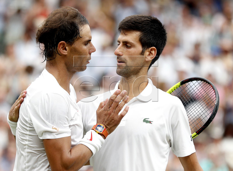 Novak Djokovic of Serbia (R) at the net with Rafael Nadal of Spain whom he defeated in their semi final match during the Wimbledon Championships at the All England Lawn Tennis Club, in London, Britain, 14 July 2018. Novak Djokovic won the final match against Kevin Anderson of South Africa. EPA-EFE/NIC BOTHMA