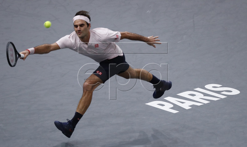 Roger Federer of Switzerland returns the ball to Novak Djokovic of Serbia during their semifinal match at the Rolex Paris Masters tennis tournament in Paris, France, 03 November 2018. EPA-EFE/CHRISTOPHE PETIT TESSON