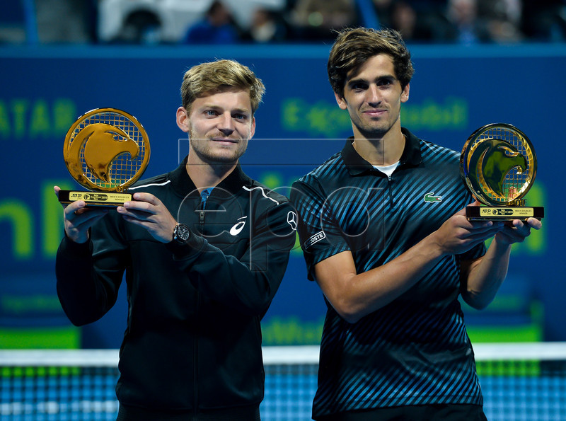 Belgium's Davif Goffin (L) and Pierre-Hugues Herbert of France pose with their trophies after winning the doubles final match against Robin Haase and Matwe Middelkoop of the Netherlands at the ATP Qatar Open Tennis tournament in Doha, Qatar, 04 January 2019. EPA-EFE/NOUSHAD THEKKAYIL