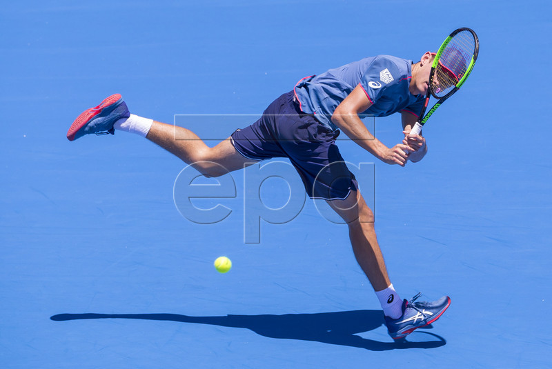 Alex De Minaur of Australia in action against Reilly Opelka of the USA during the Sydney International tennis tournament at Sydney Olympic Park Tennis Centre in Sydney, Australia, 09 January 2019. EPA-EFE/CRAIG GOLDING AUSTRALIA AND NEW ZEALAND OUT