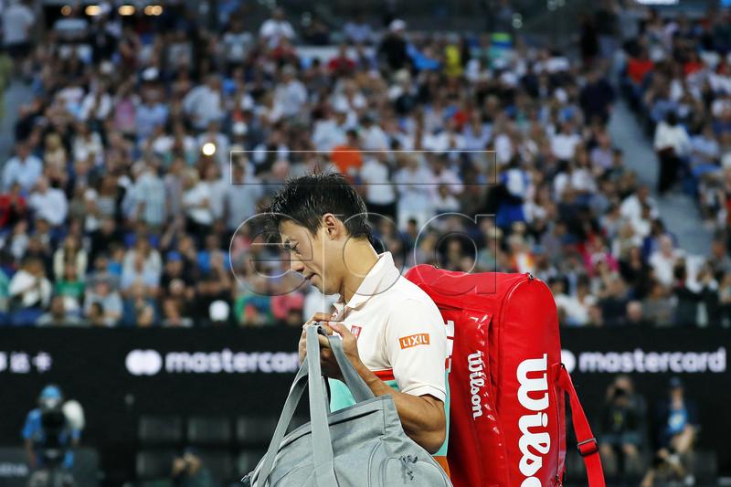 Kei Nishikori of Japan leaves the court after retiring from his men's singles quarter final match against Novak Djokovic of Serbia at the Australian Open Grand Slam tennis tournament in Melbourne, Australia, 23 January 2019. EPA-EFE/RITCHIE TONGO