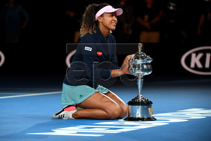 Naomi Osaka of Japan reacts during the presentation of the winner's trophy after defeating Petra Kvitova of the Czech Republic in the women's singles final at the Australian Open Grand Slam tennis tournament in Melbourne, Australia, 26 January 2019.  EPA-EFE/JULIAN SMITH EDITORIAL USE ONLY AUSTRALIA AND NEW ZEALAND OUT