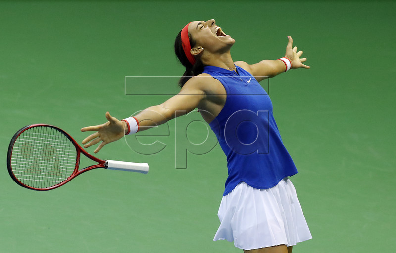 France's Caroline Garcia celebrates after her match against Belgium's Elise Mertens at the Fed Cup World Group, first round tie between Belgium and France, in Liege, Belgium, 10 February 2019. EPA-EFE/OLIVIER HOSLET