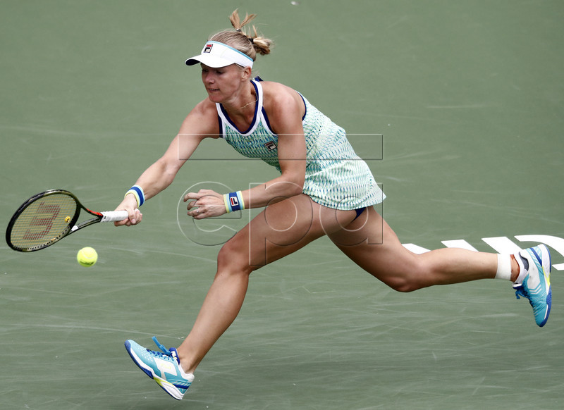 Kiki Bertens of Netherlands in action against Garbine Muguruza of Spain during the BNP Paribas Open tennis tournament at the Indian Wells Tennis Garden in Indian Wells, California, USA, 12 March 2019. The men's and women's final will be played, 17 March 2019. EPA-EFE/LARRY W. SMITH