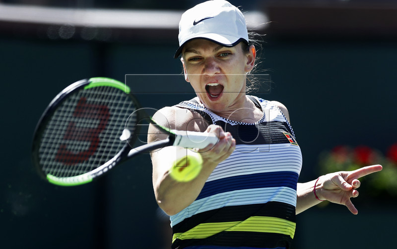 Simona Halep of Romania in action against Marketa Vondrousova of Czech Republic during the BNP Paribas Open tennis tournament at the Indian Wells Tennis Garden in Indian Wells, California, USA, 12 March 2019. The men's and women's final will be played, 17 March 2019. EPA-EFE/LARRY W. SMITH