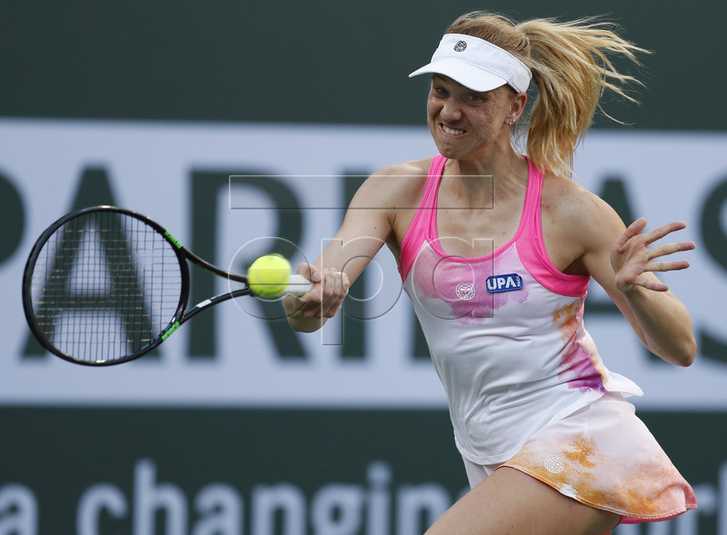 Mona Barthel of Germany in action against Venus Williams of United States during the BNP Paribas Open tennis tournament at the Indian Wells Tennis Garden in Indian Wells, California, USA, 12 March 2019. The men's and women's final will be played, 17 March 2019. EPA-EFE/JOHN G MABANGLO