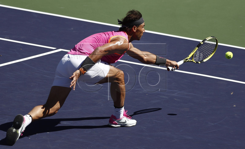 Rafael Nadal of Spain in action against Filip Krajinovic of Serbia during the BNP Paribas Open tennis tournament at the Indian Wells Tennis Garden in Indian Wells, California, USA, 13 March 2019. The men's and women's final will be played, 17 March 2019.  EPA-EFE/LARRY W. SMITH