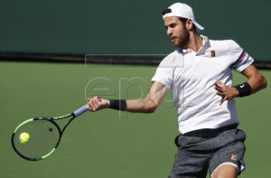 Karen Khachanov of Russia in action against John Isner of United States during the BNP Paribas Open tennis tournament at the Indian Wells Tennis Garden in Indian Wells, California, USA, 13 March 2019. The men's and women's final will be played, 17 March 2019.  EPA-EFE/LARRY W. SMITH