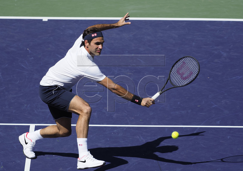 Roger Federer of Switzerland in action against Kyle Edmund of Great Britain during the BNP Paribas Open tennis tournament at the Indian Wells Tennis Garden in Indian Wells, California, USA, 13 March 2019. The men's and women's final will be played, 17 March 2019. EPA-EFE/RAY ACEVEDO
