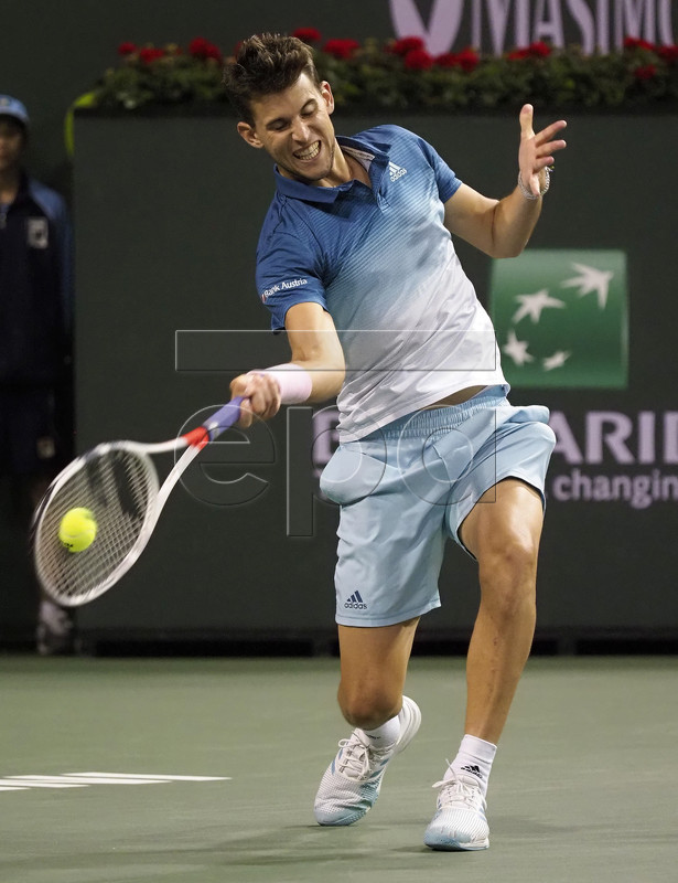 Dominic Thiem of Austria in action against Ivo Karlovic of Croatia during the BNP Paribas Open tennis tournament at the Indian Wells Tennis Garden in Indian Wells, California, USA, 13 March 2019. The men's and women's final will be played, 17 March 2019.  EPA-EFE/JOHN G. MABANGLO