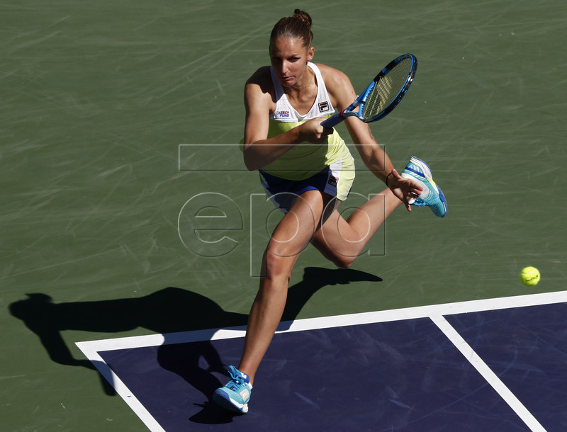 Karolina Pliskova of the Czech Republic in action against Belinda Bencic of Switzerland during the BNP Paribas Open tennis tournament at the Indian Wells Tennis Garden in Indian Wells, California, USA, 14 March 2019. The men's and women's final will be played, 17 March 2019.  EPA-EFE/LARRY W. SMITH