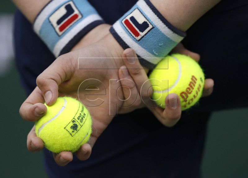 The hands of a ball boy a visible during play between Angelique Kerber of Germany and Venus Williams of the USA during the BNP Paribas Open tennis tournament at the Indian Wells Tennis Garden in Indian Wells, California, USA, 14 March 2019. EPA-EFE/JOHN G. MABANGLO