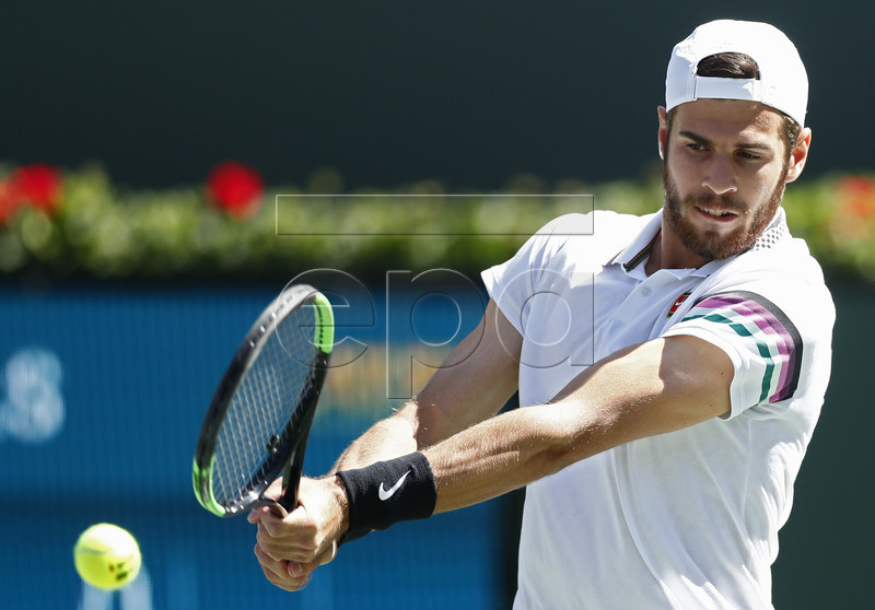 Karen Khachanov of Russia in action against Rafael Nadal of Spain during the BNP Paribas Open tennis tournament at the Indian Wells Tennis Garden in Indian Wells, California, USA, 15 March 2019. The men's and women's final will be played, 17 March 2019.  EPA-EFE/LARRY W. SMITH