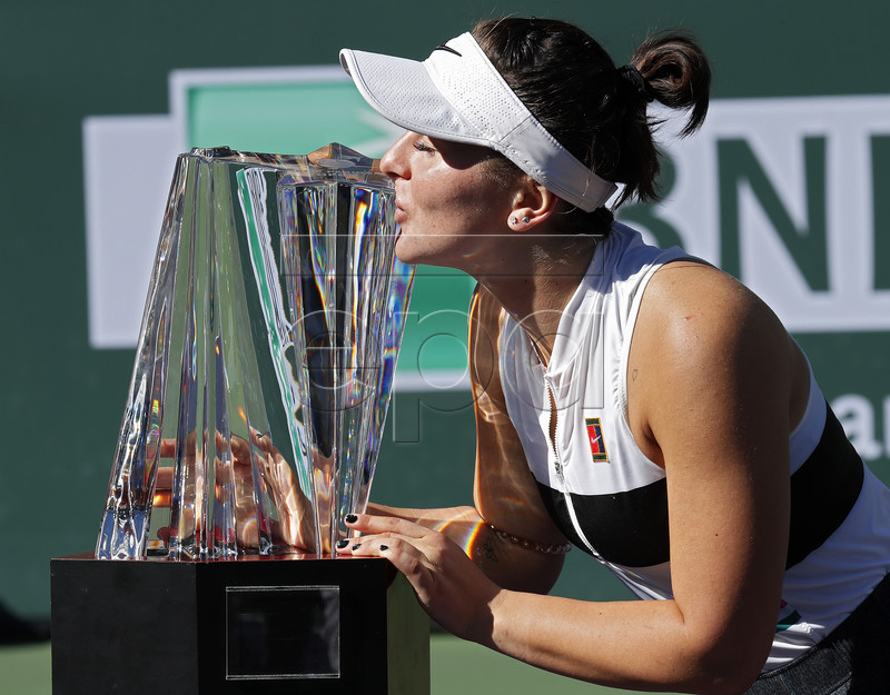 Bianca Andreescu of Canada kisses the trophy after winning against Angelique Kerber of Germany during the Finals at the BNP Paribas Open tennis tournament at the Indian Wells Tennis Garden in Indian Wells, California, USA, 17 March 2019. EPA-EFE/JOHN G MABANGLO