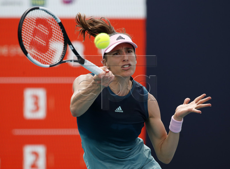Andrea Petkovic of Germany in action against Amanda Anisimova of the US during their match at the Miami Open tennis tournament in Miami, Florida, USA, 20 March 2019. EPA-EFE/JASON SZENES