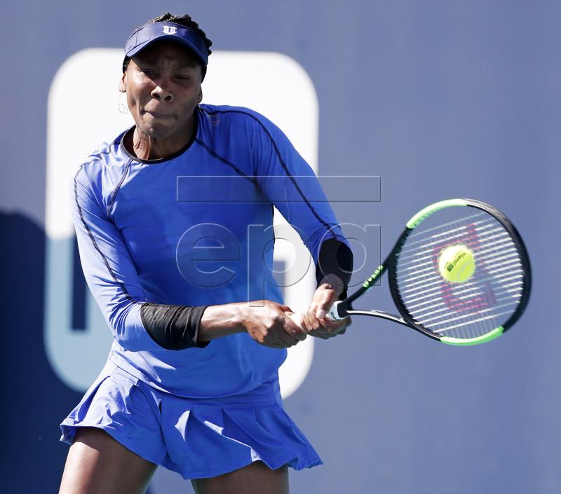 Venus Williams of the US in action against Carla Suarez Navarro of Spain during their match at the Miami Open tennis tournament in Miami, Florida, USA, 22 March 2019. EPA-EFE/JASON SZENES