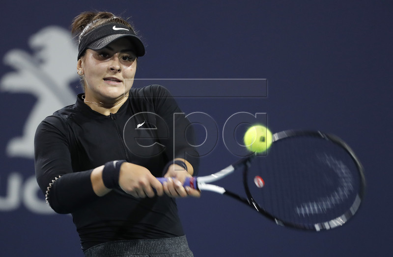 Bianca Andreescu of Canada in action against Angelique Kerber of Germany during their women's singles match at the Miami Open tennis tournament in Miami, Florida, USA, 23 March 2019. EPA-EFE/RHONA WISE