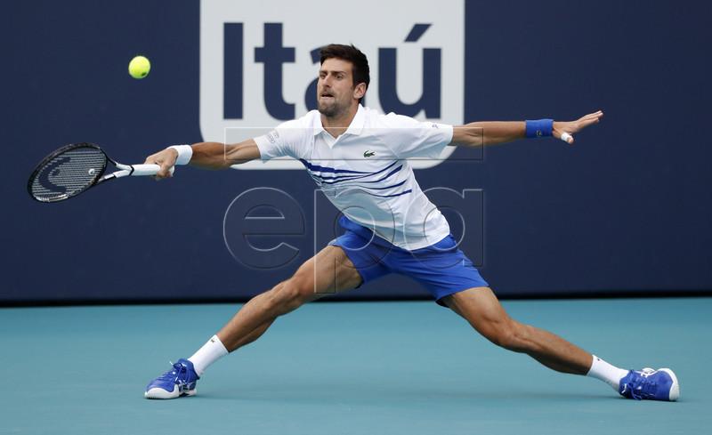Novak Djokovic of Serbia in action against Federico Delbonis of Argentina during their men's singles match at the Miami Open tennis tournament in Miami, Florida, USA, 24 March 2019. EPA-EFE/JASON SZENES