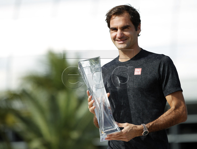 Roger Federer of Switzerland poses outside the stadium with his trophy after defeating John Isner of the US following their Men's finals match at the Miami Open tennis tournament in Miami, Florida, USA, 31 March 2019. EPA-EFE/JASON SZENES