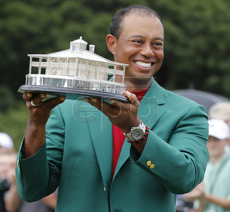 Tiger Woods of the US celebrates with his fifth green jacket after winning the 2019 Masters Tournament at the Augusta National Golf Club in Augusta, Georgia, USA, 14 April 2019. The 2019 Masters Tournament is held 11 April through 14 April 2019. EPA-EFE/ERIK S. LESSER