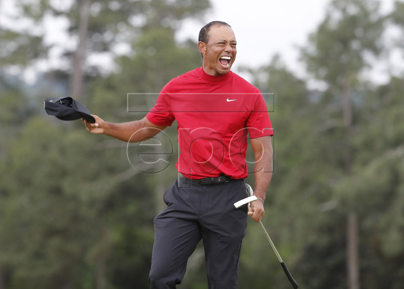 Tiger Woods of the US celebrates after winning the 2019 Masters Tournament at the Augusta National Golf Club in Augusta, Georgia, USA, 14 April 2019. The 2019 Masters Tournament is held 11 April through 14 April 2019. EPA-EFE/ERIK S. LESSER