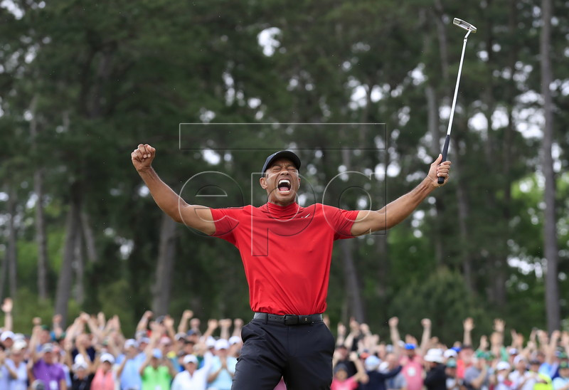Tiger Woods of the US celebrates after winning the 2019 Masters Tournament at the Augusta National Golf Club in Augusta, Georgia, USA, 14 April 2019. The 2019 Masters Tournament is held from 11 April through 14 April 2019. EPA-EFE/TANNEN MAURY