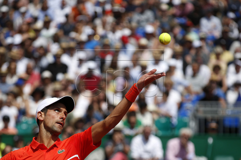 Novak Djokovic of Serbia serves the ball to Taylor Fritz of US during their third round match at the Monte-Carlo Rolex Masters tournament in Roquebrune Cap Martin, France, 18 April 2018. EPA-EFE/SEBASTIEN NOGIER