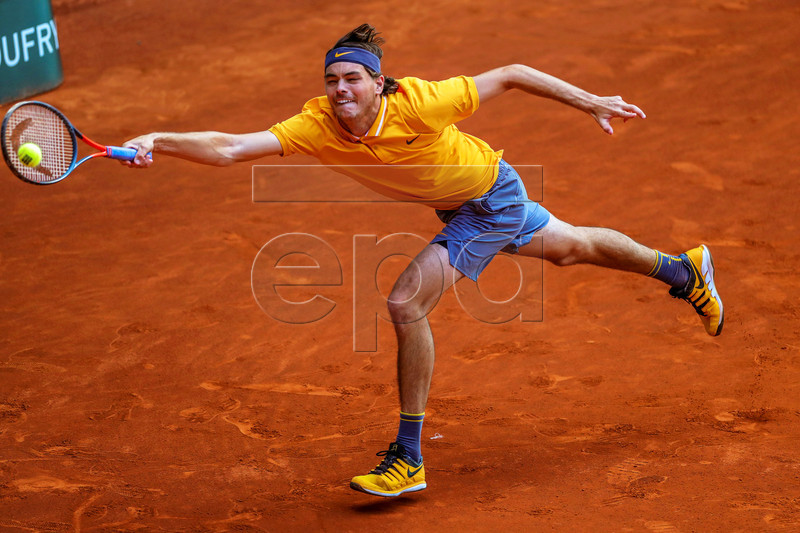 Taylor Fritz of the USA in action against Grigor Dimitrov of Bulgaria during their first round match of the Mutua Madrid Open tennis tournament at the Caja Magica complex in Madrid, Spain, 06 May 2019. EPA-EFE/JUANJO MARTIN