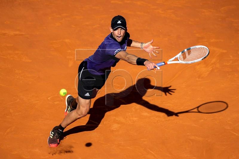 Dominic Thiem of Austria in action against Novak Djokovic of Serbia during their Mutua Madrid Open tennis semi final match at Caja Magica, in Madrid, Spain, 11 May 2019.  EPA-EFE/Rodrigo Jimenez