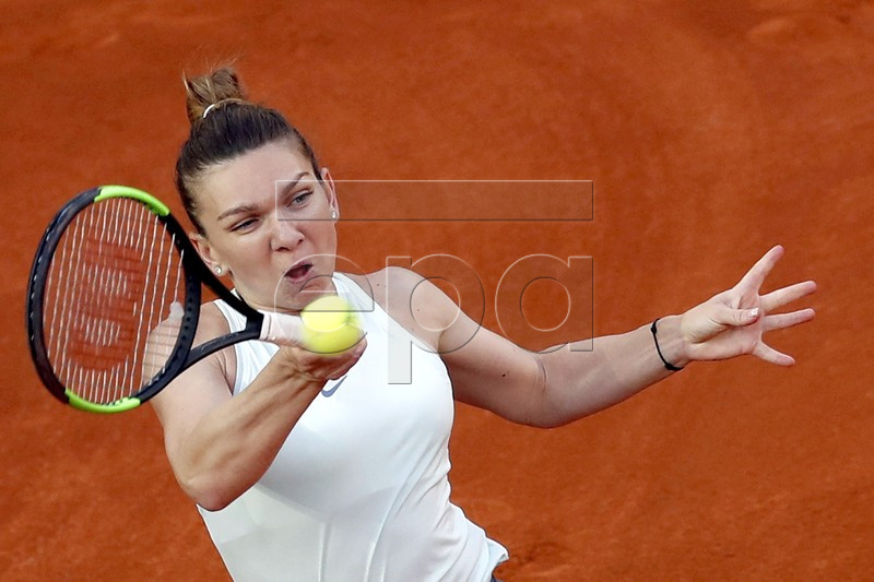 Simona Halep of Romania in action against Kiki Bertens of Netherlands during their Mutua Madrid Open tennis final game at Caja Magica, in Madrid, Spain, 11 May 2019. EPA-EFE/Javier Lizon