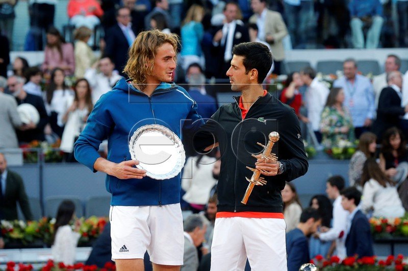 Novak Djokovic of Serbia (R) and Stefanos Tsitsipas of Greece (L) pose for the photographers after their Mutua Madrid Open tennis final game at Caja Magica, in Madrid, Spain, 12 May 2019. EPA-EFE/KIKO HUESCA