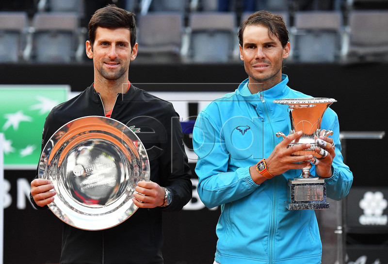 Rafael Nadal (R) of Spain poses with his trophy after defeating Novak Djokovic (L) of Serbia in their men's singles final match at the Italian Open tennis tournament in Rome, Italy, 19 May 2019.  EPA-EFE/ETTORE FERRARI