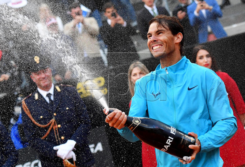 Rafael Nadal of Spain celebrates after defeating Novak Djokovic of Serbia in their men's singles final match at the Italian Open tennis tournament in Rome, Italy, 19 May 2019.  EPA-EFE/ETTORE FERRARI
