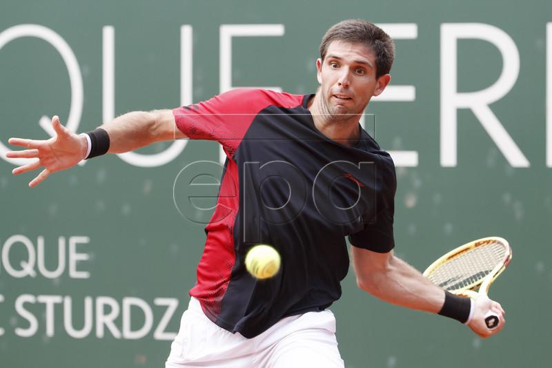 Federico Delbonis of Argentina in action during his match against Grigor Dimitrov of Bulgaria at the ATP 250 Geneva Open tennis tournament in Geneva, Switzerland, 21 May 2019. EPA-EFE/SALVATORE DI NOLFI
