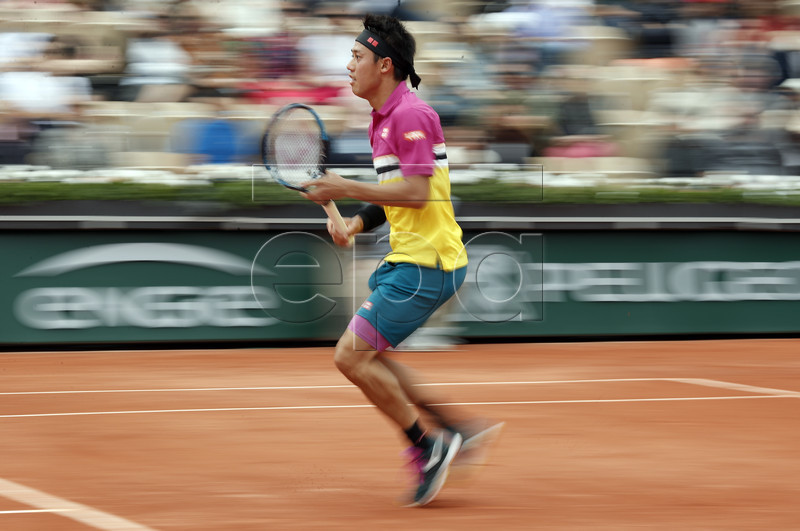 Kei Nishikori of Japan plays Quentin Halys of France during their men?s first round match during the French Open tennis tournament at Roland Garros in Paris, France, 26 May 2019.  EPA-EFE/YOAN VALAT