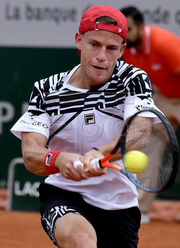 Diego Schwartzman of Argentina plays Marton Fucsovics of Hungary during their men?s first round match during the French Open tennis tournament at Roland Garros in Paris, France, 26 May 2019.  EPA-EFE/JULIEN DE ROSA