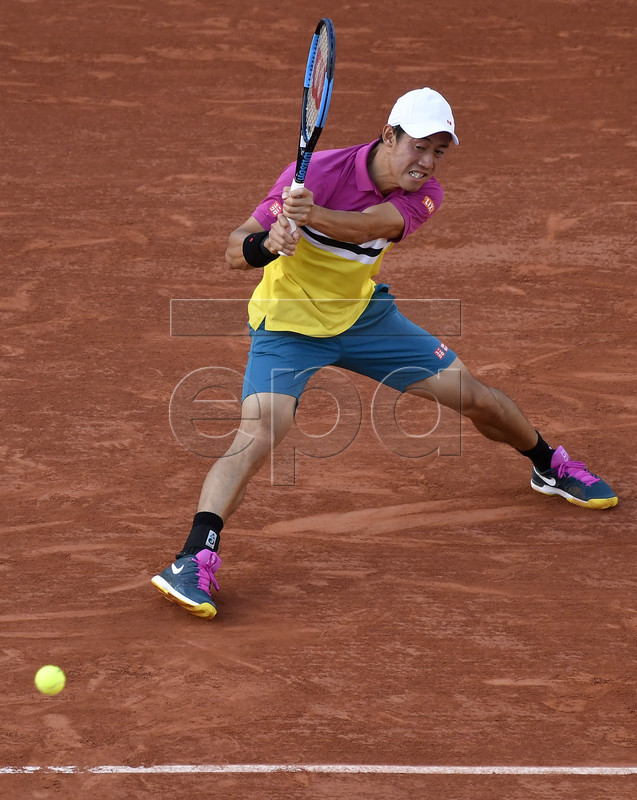 Kei Nishikori of Japan plays Benoit Paire of France during their men?s round of 16 match during the French Open tennis tournament at Roland Garros in Paris, France, 02 June 2019. EPA-EFE/JULIEN DE ROSA