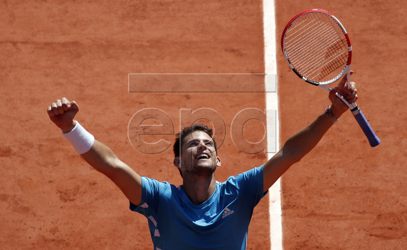 Dominic Thiem of Austria reacts after winning against Novak Djokovic of Serbia their men?s semi final match during the French Open tennis tournament at Roland Garros in Paris, France, 08 June 2019. EPA-EFE/YOAN VALAT