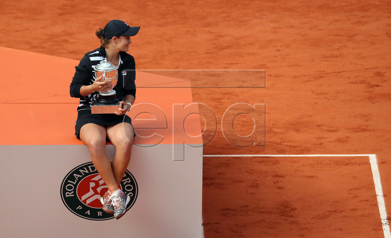 Ashleigh Barty of Australia poses with the trophy after winning the women?s final match against Marketa Vondrousova of the Czech Republic during the French Open tennis tournament at Roland Garros in Paris, France, 08 June 2019. EPA-EFE/SRDJAN SUKI