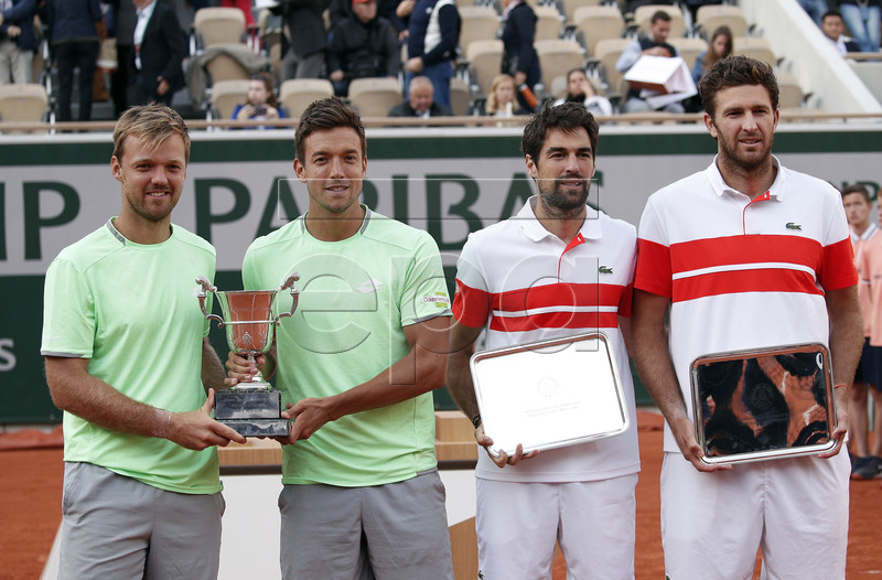 Winner Kevin Krawietz (L) and Andreas Mies of Germany (2L) and runner-up Jeremy Chardy (2R) and Fabrice Martin of France (R) pose with their trophy after winning the men?s doubles final match during the French Open tennis tournament at Roland Garros in Paris, France, 08 June 2019. EPA-EFE/YOAN VALAT
