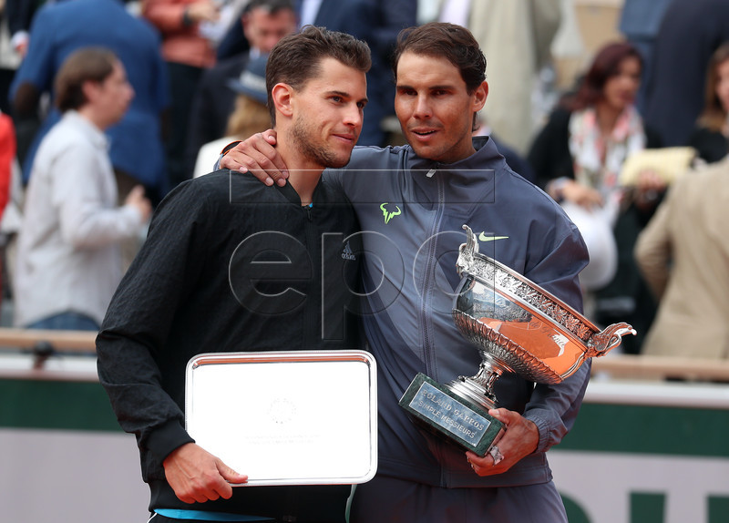 Winner Rafael Nadal of Spain (R) and runner-up Dominic Thiem of Austria pose with their trophies after their men?s final match during the French Open tennis tournament at Roland Garros in Paris, France, 09 June 2019. EPA-EFE/SRDJAN SUKI
