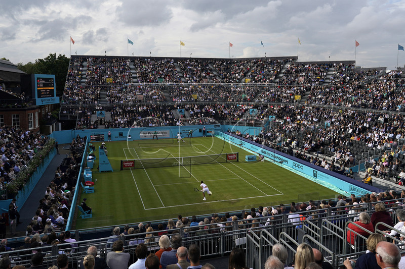 Spectators watch Switzerland's Stan Wawrinka during his round 32 match against Britain's Dan Evans at the Fever Tree Championship at Queen's Club in London, Britain, 19 June 2019. EPA-EFE/WILL OLIVER