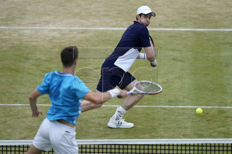 Britain's Andy Murray (R) returns during his mens doubles final match with Feliciano Lopez of Spain against Britain's Joe Salisbury and Rajeev Ram at the Fever Tree Championship at Queen's Club in London, Britain, 23 June 2019. The tournament runs from 17th June till 23 June 2019. EPA-EFE/WILL OLIVER
