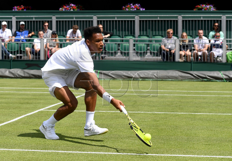 Felix Auger Aliassime from Canada in action against Vasek Pospisil of Canada during their first round match at the Wimbledon Championships at the All England Lawn Tennis Club, in London, Britain, 01 July 2019. EPA-EFE/FACUNDO ARRIZABALAGA EDITORIAL USE ONLY/NO COMMERCIAL SALES