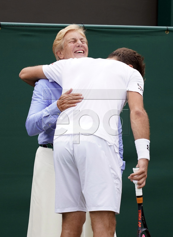 Stan Wawrinka of Switzerland embraces a lines woman as he plays Reilly Opelka of USA in their second round match during the Wimbledon Championships at the All England Lawn Tennis Club, in London, Britain, 03 July 2019. EPA-EFE/WILL OLIVER EDITORIAL USE ONLY/NO COMMERCIAL SALES