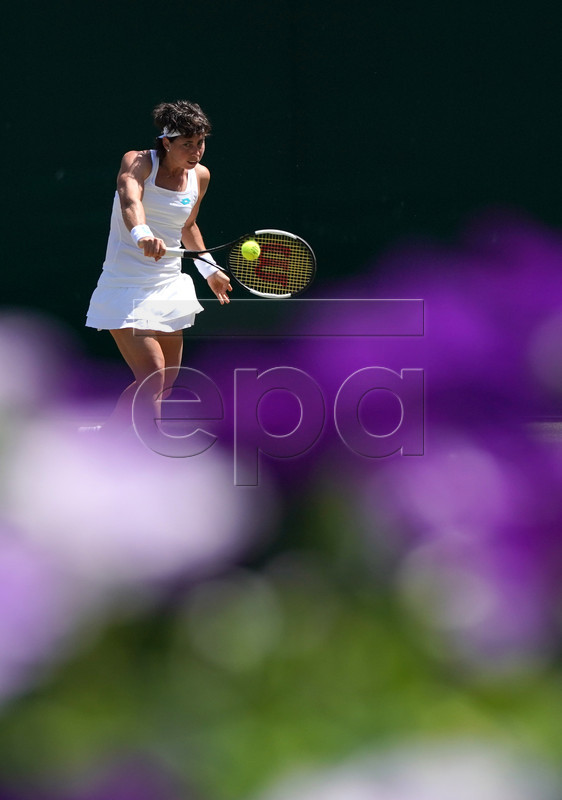 Carla Suarez Navarro of Spain in action against Pauline Parmentier of France during their second round match at the Wimbledon Championships at the All England Lawn Tennis Club, in London, Britain, 04 July 2019. EPA-EFE/NIC BOTHMA EDITORIAL USE ONLY/NO COMMERCIAL SALES