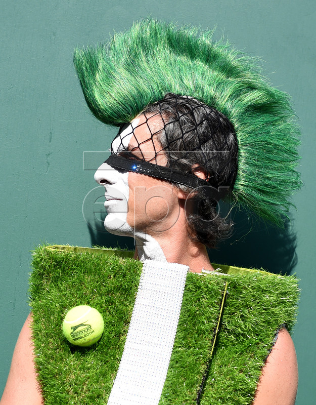 Tennis enthusiast poses for photographers during fourth round action at the Wimbledon Championships at the All England Lawn Tennis Club, in London, Britain, 08 July 2019. EPA-EFE/FACUNDO ARRIZABALAGA EDITORIAL USE ONLY/NO COMMERCIAL SALES