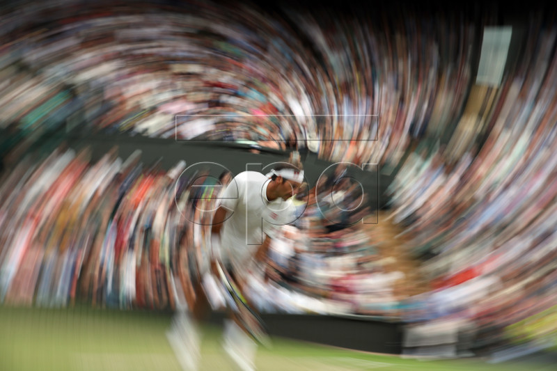 Roger Federer of Switzerland serves to Matteo Berrettini of Italy in their fourth round match during the Wimbledon Championships at the All England Lawn Tennis Club, in London, Britain, 08 July 2019. EPA-EFE/NIC BOTHMA EDITORIAL USE ONLY/NO COMMERCIAL SALES