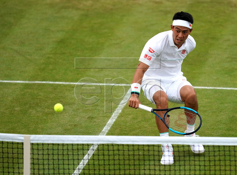 Kei Nishikori of Japan in action against Mikhail Kukushkin of Kazakhstan in their fourth round match during the Wimbledon Championships at the All England Lawn Tennis Club, in London, Britain, 08 July 2019. EPA-EFE/WILL OLIVER EDITORIAL USE ONLY/NO COMMERCIAL SALES